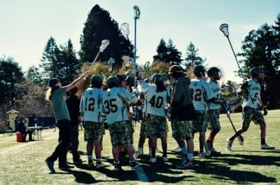 The Humboldt State Hogs Men's Lacrosse team holding up their sticks as they break away from a timeout. Men's Lacrosse ended up losing 13-3 against Sierra Nevada College at Humboldt States College Creek events field on Saturday Feb. 25, 2017. | Juan Herrera